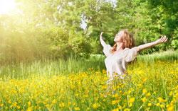 Woman in sunny field